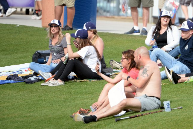 Fans enjoy the warm weather as they watch the San Diego Padres play the Texas Rangers at Peoria Stadium in Peoria, Ariz., on March 7. Photo by Art Foxall/UPI