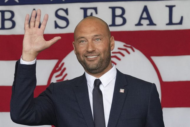 Longtime New York Yankees shortstop Derek Jeter waves at the 2021 Baseball Hall of Fame Induction Ceremony for the class of 2020 Wednesday in Cooperstown, N.Y. Photo by Pat Benic/UPI