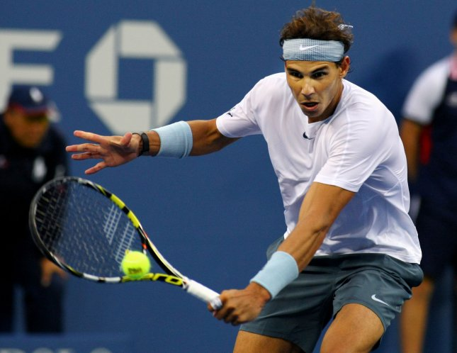 Rafael Nadal, shown at this year's U.S. Open, defeated David Ferrer in straight sets Tuesday in a Group A match of the ATP World Tour Finals. UPI /Monika Graff