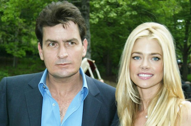 Charlie Sheen (L) and Denise Richards at the CBS Upfront on May 14, 2003. The actor denied threatening to kill Richards on Wednesday's episode of The Dr. Oz Show. File Photo by Laura Cavanaugh/UPI