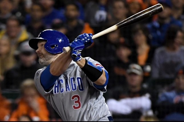 Chicago Cubs' David Ross drives in a run with a sac fly in the 5th inning against the San Francisco Giants in the National League Division Series Game 4 at AT&T Park in San Francisco on October 11, 2016. Photo by Terry Schmitt/UPI