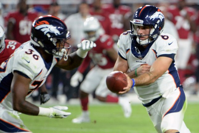 Former Denver Broncos quarterback Chad Kelly (R) hands off to running back David Williams in the second quarter against the Arizona Cardinals on August 30, 2018 at University of Phoenix Stadium in Glendale, Arizona. Photo by Art Foxall/UPI