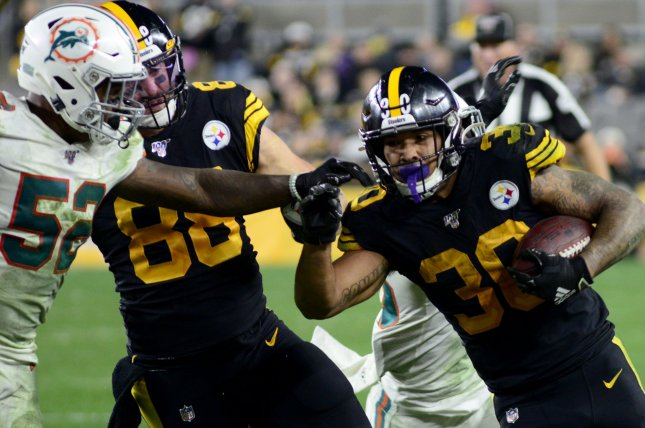 Pittsburgh Steelers running back James Conner (30) has scored touchdowns in four consecutive games. Photo by Archie Carpenter/UPI