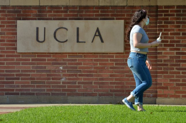 A masked student is seen walking at the University of California, Los Angeles campus in Los Angeles, Calif., on May 13. The campus and all other California colleges temporarily closed physical classes due to the coronavirus pandemic. File Photo by Jim Ruymen/UPI