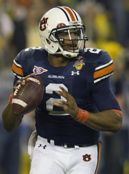 Heisman trophy winner and Auburn Tigers quarterback Cam Newton rolls out to pass against the Oregon Ducks during the second quarter at the BCS Championship game at the University of Phoenix stadium in Glendale, Arizona on January 10, 2011. UPI/Gary C. Caskey