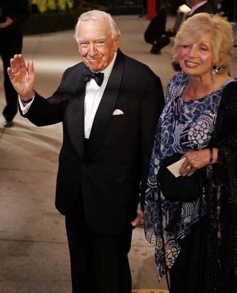 Walter Cronkite (L) and friend arrive at the Vanity Fair post-79th Academy Awards party at Morton's in West Hollywood on February 25, 2007. (UPI Photo/Gary C. Caskey)