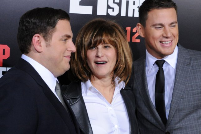 Sony co-chainman Amy Pascal with actors Jonah Hill (L) and Channing Tatum (R) on March 13, 2012. UPI/Jim Ruymen
