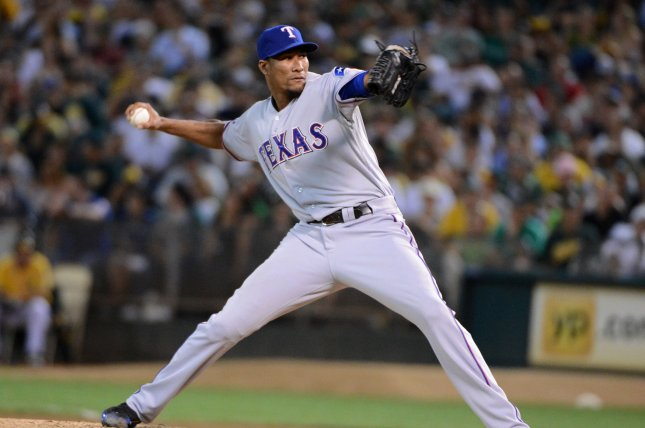 The Boston Red Sox signed pitcher Alexi Ogando to a 1 year contract. File Photo by UPI/Terry Schmitt.