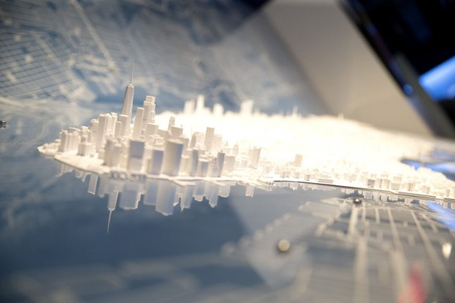 Chelsea Norwich and a team from Brooklyn spent more than a year designing and building this model of Manhattan Island. It was on display Tuesday at the opening of Gulliver's Gate in New York City's Times Square. Photo by John Angelillo/UPI
