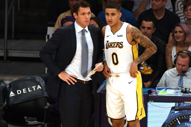 93c7c962f47e Los Angeles Lakers head coach Luke Walton (L) talks to forward Kyle Kuzma  during second quarter action against the Memphis Grizzlies (9) on November  5 at ...
