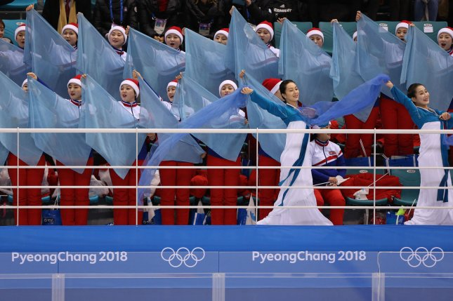 North Korean cheerleaders wave the reunification flags during the women's ice hockey preliminary round between Sweden and the joint North-South Korean team on Monday. Some have criticized Seoul for extending an invitation to a massive delegation of North Korean supporters when only a few qualified for the Olympics.Photo by Andrew Wong/UPI