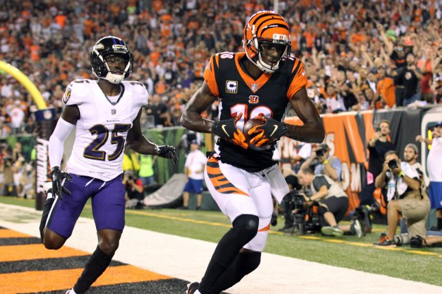 Cincinnati Bengals wide receiver A.J. Green (18) makes a touchdown catch under pressure from Baltimore Ravens defensive back Tavon Young (25) during the first half of play on Thursday at Paul Brown Stadium in Cincinnati. Photo by John Sommers II/UPI