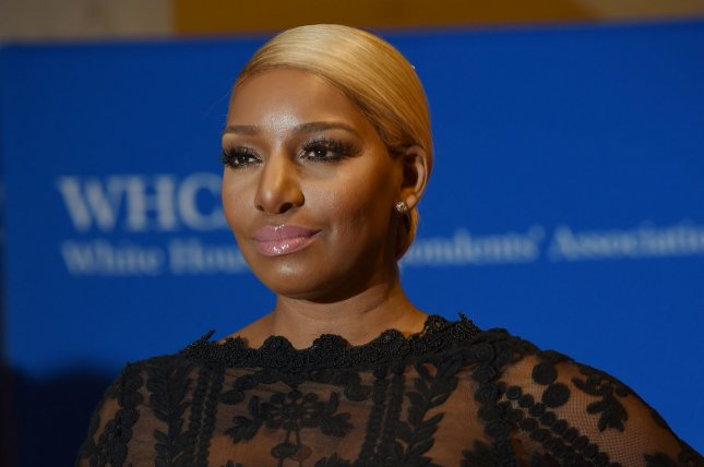 NeNe Leakes celebrated on Instagram after husband Gregg Leakes finished a first round of treatment for colon cancer. File Photo by Molly Riley/UPI