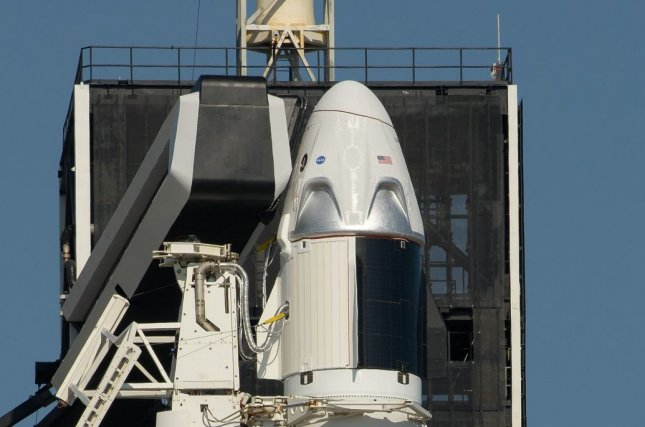SpaceX's Crew Dragon capsule sits atop a Falcon 9 rocket on Thursday in preparation for next week's  launch of two astronauts to the International Space Station. NASA Photo by Bill Ingalls/UPI