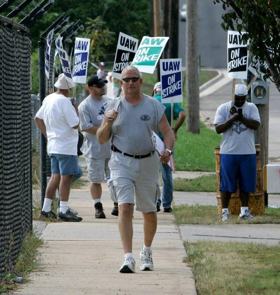 Striking members of United Auto Workers Local 95 picket at the General Motors assembly plant on September 24, 2007, in Janesville, Wis. On September 26, 2007, ending a walkout that lasted less than two days, the United Auto Workers union and General Motors reached a deal in which GM agreed to create a $38.5 billion trust to administer health benefits for retirees. File Photo by Brian Kersey/UPI