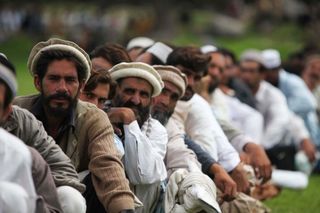 Pakistani civilians wait to board a CH-53E Super Stallion helicopter during humanitarian relief efforts in the Khyber-Pakhtunkhwa province, Pakistan on August 18, 2010 after massive floods devastated the country. UPI/Paul Duncan/U.S. Military