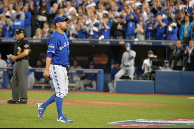 Toronto Blue Jays starting pitcher Marco Estrada walks to the dugout to a standing ovation after being relieved in the eighth inning against the Kansas City Royals in the ALCS game 5 at the Rogers Centre in Toronto, Canada on October 21, 2015. Kansas City holds a 3-1 series lead over Toronto. Photo by Kevin Dietsch/UPI