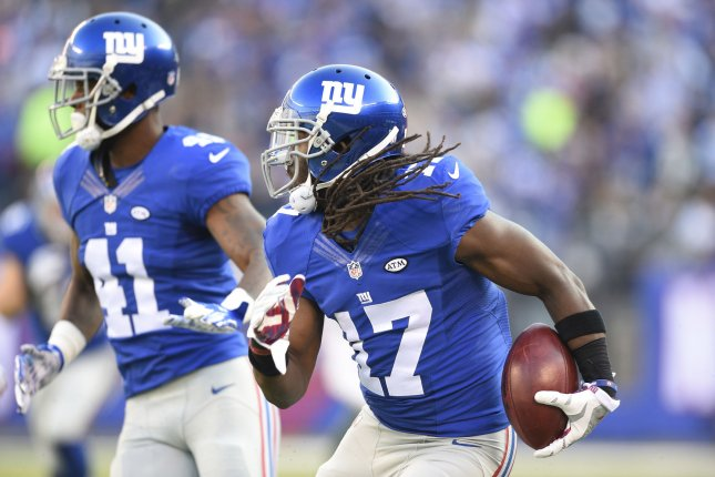 New York Giants wide receiver Dwayne Harris (17) runs back a 80 yard punt return in the 2nd quarter against the New York Jets at MetLife Stadium in East Rutherford, New Jersey on December 6, 2015. Photo by Rich Kane/UPI