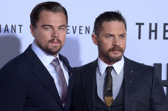 Cast members Leonardo DiCaprio (L) and Tom Hardy attending the premiere of The Revenant on December 16, 2015. Hardy must know get a tattoo designed by DiCaprio after losing a bet based on last year's Oscar nominations. File Photo by Jim Ruymen/UPI
