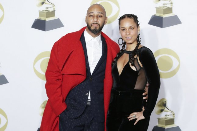 Alicia Keys (R) and Swizz Beatz attend the Grammy Awards on Sunday. Photo by John Angelillo/UPI
