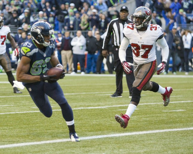 Tampa Bay Buccaneers defensive back Keith Tandy (37) chases after Seattle Seahawks receiver Doug Baldwin during a game in 2013. File photo by Jim Bryant/UPI