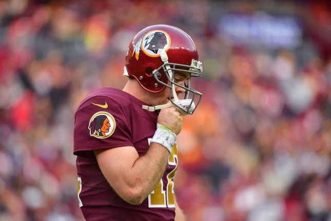 Washington Redskins quarterback Colt McCoy (12) leaves the field in the closing moments of a game against the Houston Texans on November 18 at FedEx Field in Landover, Md. Photo by Kevin Dietsch/UPI