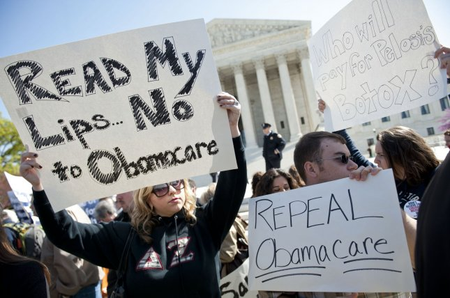 Protesters gather in front of the U.S. Supreme Court as the court heard arguments on the constitutionality of the Affordable Care Act in Washington, D.C. on March 26, 2012. The Supreme Court upheld the law in 2012, but a decision by a federal judge in Texas this week has cast doubt on Obamacare. File Photo UPI/Kevin Dietsch