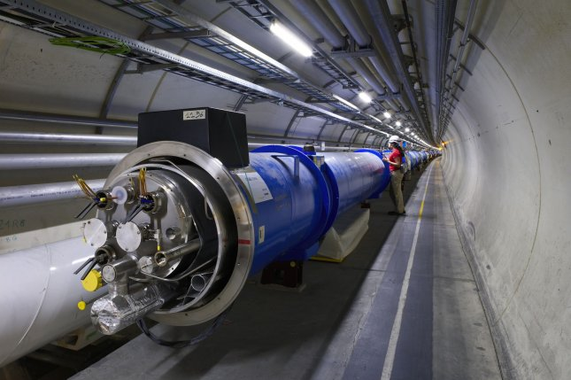 In a October 24, 2005, handout image from the European Organization for Nuclear Research, two Large Hadron Collider magnets are seen before they are connected together. On September 10, 2008, scientists in a Geneva lab activated the Large Hadron Collider, the world's largest and most powerful subatomic particle accelerator, built over a 14-year period and costing an estimated $8 billion. It had to be shut down after nine days for repairs. File Photo by Maximilien Brice/CERN