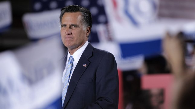 Republican presidential candidate Mitt Romney pauses as the crowd cheers during a speech at the Radisson in Manchester, New Hampshire on April 24, 2012. UPI/Matthew Healey