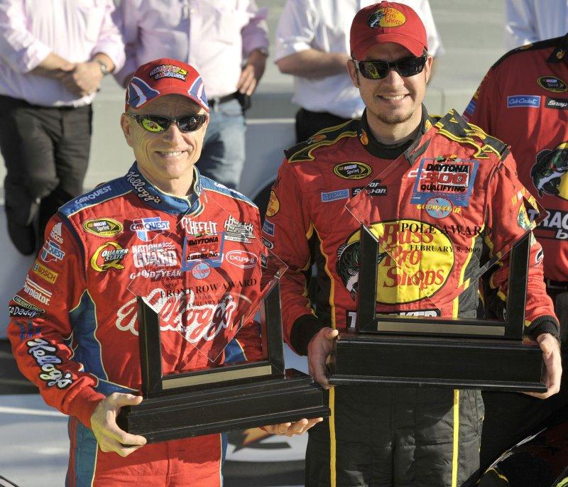 Martin Truex Jr., right, and Mark Martin hold their front row trophies Feb. 8, 2009, for the Daytona 500. (UPI Photo/Jeff Paul Emmans)