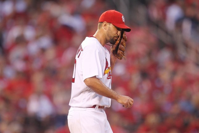 St. Louis Cardinals starting pitcher Adam Wainwright wipes his face with his glove after giving up a two RBI single in the fourth inning against the New York Mets at Busch Stadium in St. Louis on August 25, 2016. Photo by Bill Greenblatt/UPI