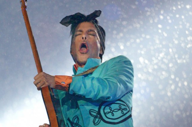 Prince performs in the rain at halftime at Super Bowl XLI at Dolphin Stadium in Miami in 2007. The award-winning singer-songwriter died at his Paisley Park home in Chanhassen, Minn., on April 21, 2016, at age 57. File Photo by Terry Schmitt/UPI