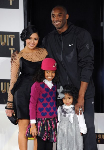 Kobe Bryant (R) with wife Vanessa and daughters Natalia and Gianna at his TCL Chinese Theatre hand and footprint ceremony on February 19, 2011. File Photo by Jim Ruymen/UPI