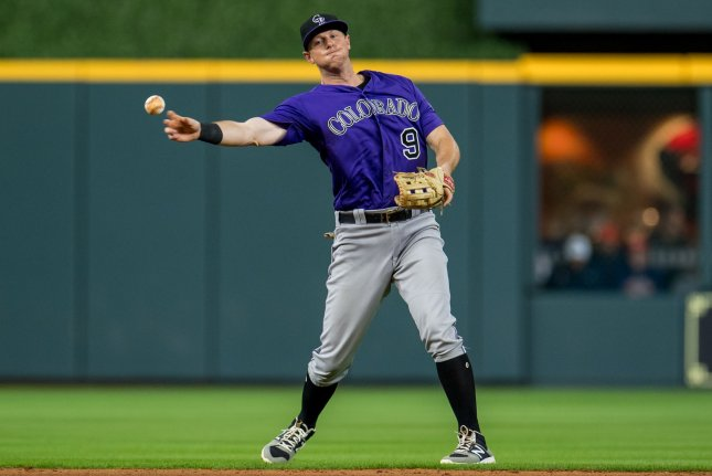 Former Colorado Rockies second baseman DJ LeMahieu throws to first to record an out against the Houston Astros in the sixth inning on August 15 at Minute Made Park in Houston. Photo by Trask Smith/UPI