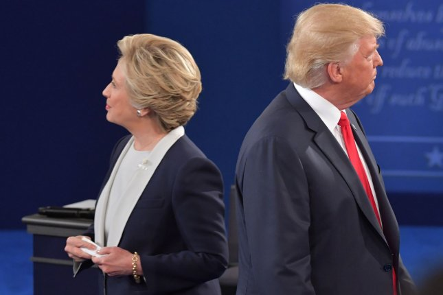 Presidential candidates Hillary Clinton and Donald Trump attend a debate at Washington University in St. Louis, Mo., on October 8, 2016. File Photo by Kevin Dietsch/UPI