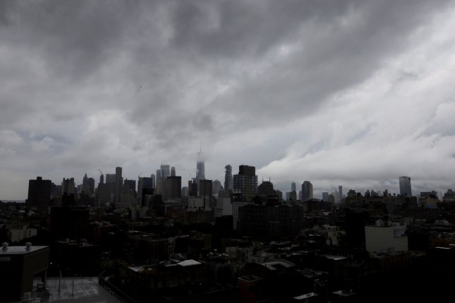 Dark ominous clouds are seen over the Manhattan skyline in New York City. Forecasters predict a Nor'easter this week they say will bring snow to parts of New York and New England. File Photo by John Angelillo/UPI