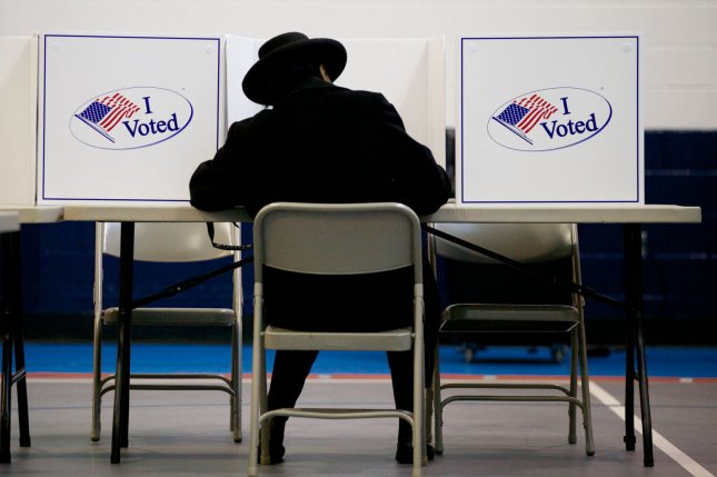One of the new laws restores voting rights for about 80,000 New Jersey residents on parole or probation. File Photo by Molly Riley/UPI