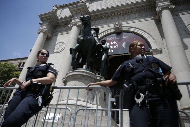 Police barricades surround the bronze statue of former President Theodore Roosevelt Monday at the American Museum Of Natural History in New York City. Photo by John Angelillo/UPI