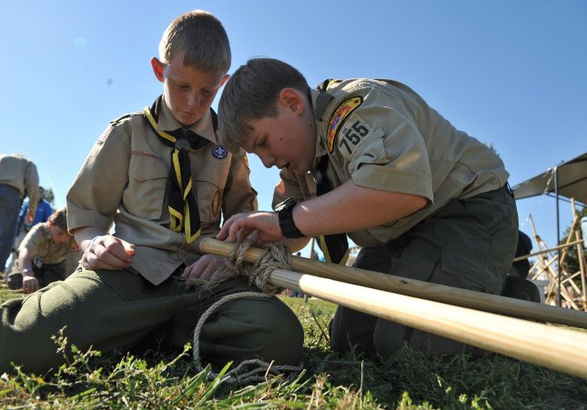 Brian Lanzillotta (R), 11, and Nick Victor,11, both from Troop 755 practice lashing during the Star-Spangled Camporee and celebration of the 100th Anniversary of the Boy Scouts of America at Fort McHenry in Baltimore on October 2, 2010. UPI/Kevin Dietsch