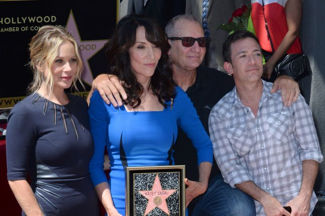 Actress Katey Sagal holds a replica plaque during an unveiling ceremony honoring her with the 2,529th star on the Hollywood Walk of Fame in Los Angeles on September 9, 2014. Joining Sagal left to right are her Married With Children castmates Christina Applegate, (Sagal), Ed O'Neill and David Faustino. UPI/Jim Ruymen