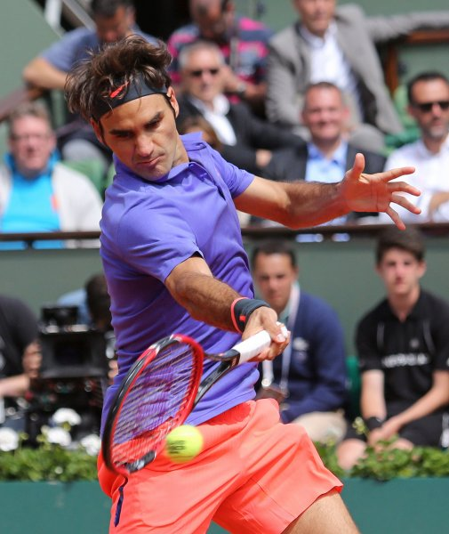 Roger Federer of Switzerland hits a shot during his French Open men's third round match against Damir Dzumhur of Bosnia and Herzegovina at Roland Garros in Paris on May 29, 2015. Federer defeated Dzumhur 6-4, 6-3, 6-2 to advance to the next round. Photo by David Silpa/UPI