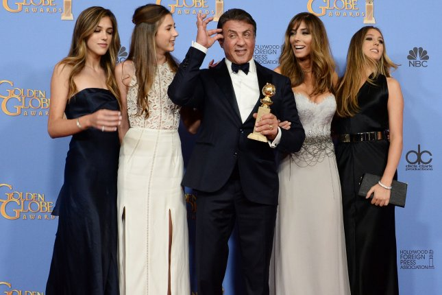Actor Sylvester Stallone, winner of the award for Best Performance by an Actor in a Supporting Role in a Motion Picture for Creed, appears backstage with his wife Jennifer and their three daughters during the 73rd annual Golden Globe Awards on January 10, 2016. File Photo by Jim Ruymen/UPI