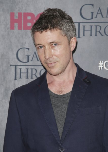 Aidan Gillen arrives on the red carpet at the Game of Thrones Season 4 premiere in New York City on March 18, 2014. The Irish actor can now be seen in King Arthur: Legend of the Sword. File Photo by John Angelillo/UPI