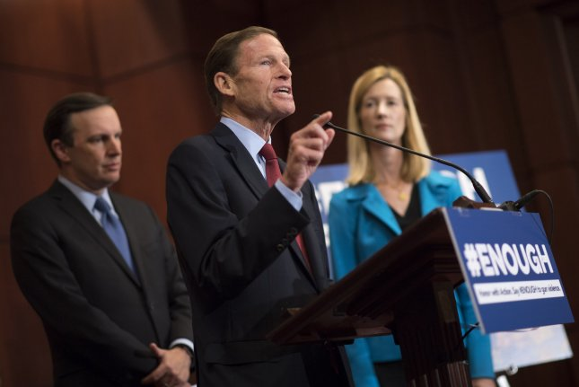 Sen. Richard Blumenthal, D-Conn., (C) is joined by Avery Gardiner, co-president of the Brady Campain to Prevent Gun Violence, and Sen. Chris Murphy, D-Conn., (L) as he speaks on the recent mass shooting in Las Vegas and introduction of a bill strengthening gun background checks on Capitol Hill in Washington, D.C., on Tuesday. Photo by Kevin Dietsch/UPI