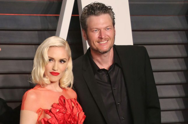Blake Shelton (R), pictured with Gwen Stefani, gushed about the singer in a new interview with Sunday Today. File Photo by David Silpa/UPI