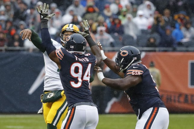 Green Bay Packers quarterback Brett Hundley (7) passes the ball against Chicago Bears outside linebacker Leonard Floyd (94) and nose tackle Eddie Goldman (91) during the first half on November 12 at Soldier Field in Chicago. Photo by Kamil Krzaczynski/UPI