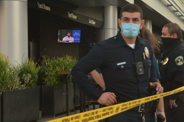 A masked police officer stands near the Yard House restaurant in Los Angeles, Calif., on Sunday as fans watch the sixth game of the NBA Finals between the Los Angeles Lakers and Miami Heat. Photo by Jim Ruymen/UPI