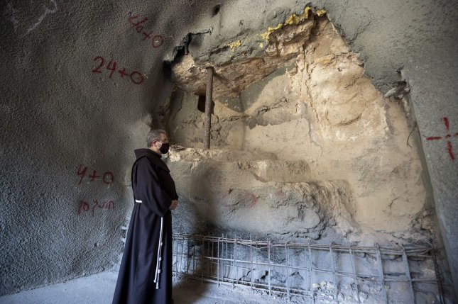 Father Francesco Patton, Custos of the Holy Land, on Monday shows the remains of a 2,000-year-old Jewish ritual bath that was discovered at the site from the time of Jesus. According to the Israel Antiquities Authority, it's one of the first archaeological evidences of its kind of Second Temple-period activity at the Gethsemane Church. Photo by Atef Safadi/UPI/Pool