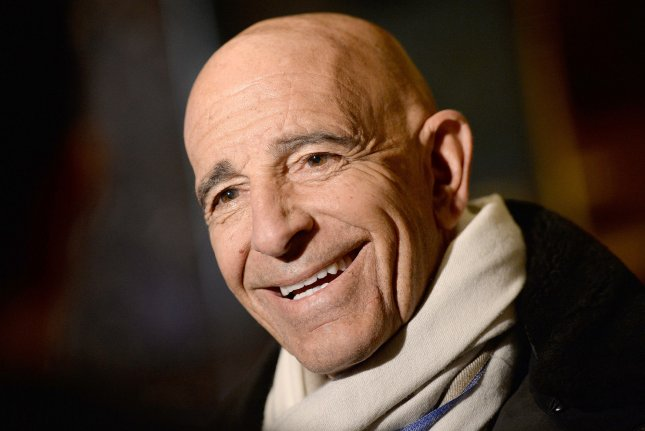 Thomas Barrack, a wealthy investor and chairman former President Donald Trump's inaugural committee, is shown talking to reporters in the lobby of the Trump Tower in New York on January 10, 2017. File photo by Anthony Behar/UPI/Pool