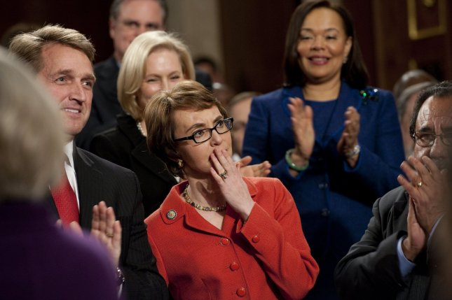 US Representative Gabrielle Giffords (D-AZ) arrives as members of Congress applaud before US President Barack Obama's State of the Union address in front of a joint session of Congress on January 24, 2012 at the US Capitol in Washington, DC. UPI/Saul Loeb/Pool